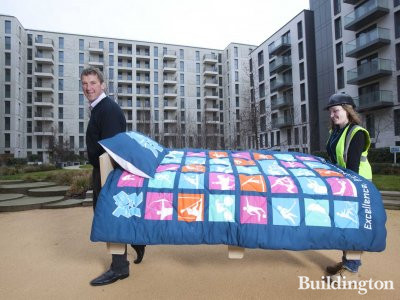 London 2012 begins 'bedding in' at Olympic Village 6 months ahead of the Games. Olympian Matthew Pinsent helps lift in the first of 16,000 beds to be installed in Village as the ODA completes construction of apartments on time and LOCOG begins Games-time fit-out of Village.