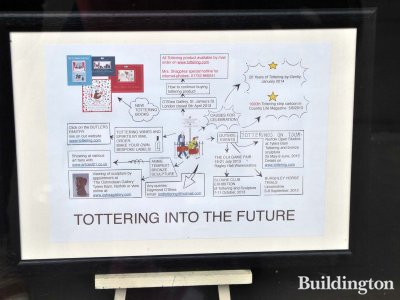 Tottering Into The Future on 4 St James's Street window in May 2013.