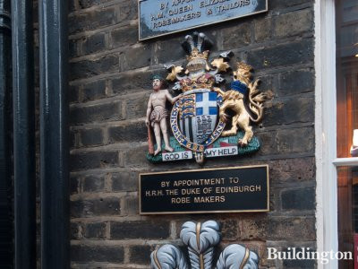 Royal warrants of appointment outside Ede & Ravenscroft store - London's oldest tailor formally established in 1689.