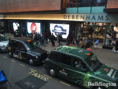 Taxis waiting for shoppers in front of the Debenhams department store in 2016.