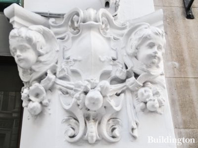 Putti sculpture at 70-72 Jermyn Street building in St James's, London SW1.