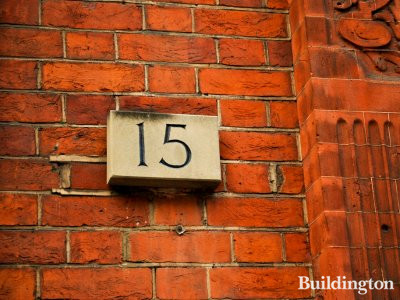 House number on the facade at 15 Palace Court in Bayswater, London W2.
