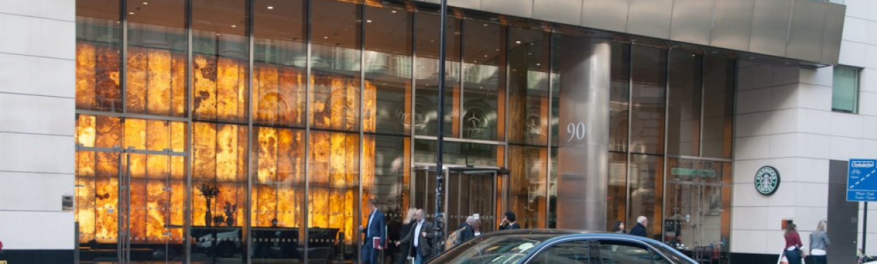 Entrance to 90 High Holborn office building. Starbucks on the ground floor next to the main entrance.