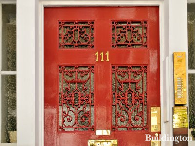 Close-up of the red door at 111 Harley Street.