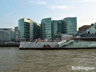View to 1 More London Place and HMS Belfast in front of it from the River Thames.