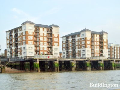 Tudor Court and Woolcombes Court apartment buildings on the banks of the River Thames.