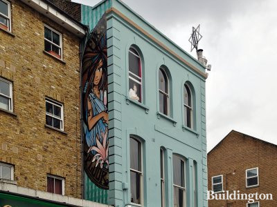 First Floor & girl with a flower on the side of the building in 2013; Street art by Inkie at 186 Portobello Road in Notting Hill, London W11.