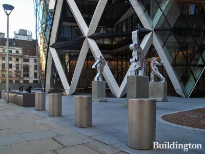 Caterina Dancing Naked by Julian Opie and 30 St Mary Axe building in the City of London EC3.
