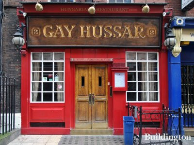 In front of The Gay Hussar in Soho, London W1.