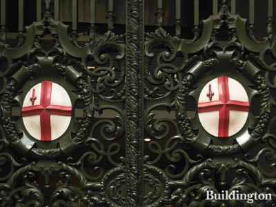 Coat of arms of the City of London on the gates at the Royal Exchange.