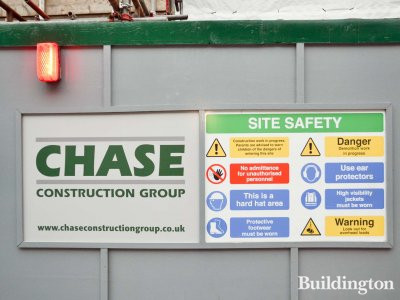 Chase Construction Group banner on the hoarding at 21-23 Farm Street.