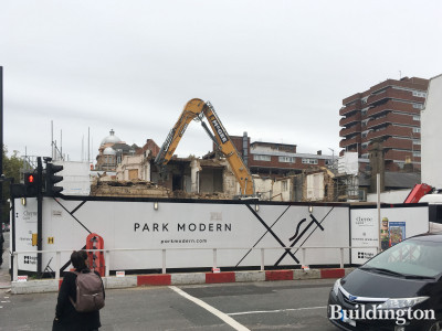 McGee demolishing the buildings at Park Modern; view from Inverness Terrace.