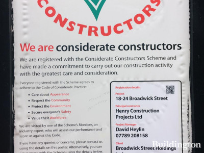 Considerate Constructors poster at 22-24 Berwick Street development in Soho, London W1.