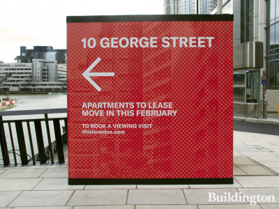 Sign on Water Street pointing to the 10 George Street building