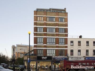 Bains Mansions flats above retail premises. TNT Clothing and Zana storefronts on Commercial Road.
