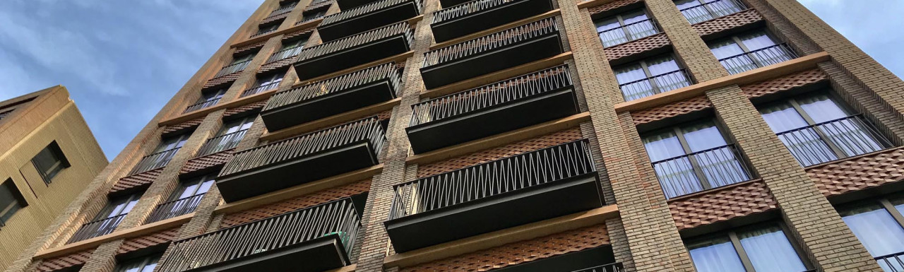 Fenman House front elevation on Lewis Cubitt Walk. Apartments are overlooking the Lewis Cubitt Park.