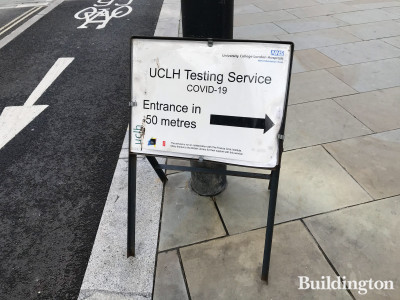 A sign on Midland Road pointing towards the UCLH COVID-19 testing service entrance at Francis Crick Institute.