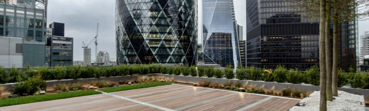 View to 6 Bevis Marks, 30 St Mary Axe, The Scalpel and St Helen's tower from the roof terrace at 100 Bishopsgate. Adjustable pedestals by Buzon.