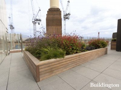 Terrace with a view to the power station at Circus West Village within the Battersea Power Station development. Adjustable pedestals by Buzon.