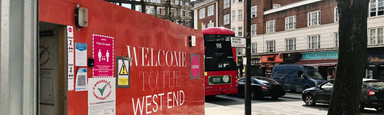 Welcome to the West End. Native Land's banner at the entrance to TwentyFive construction site on Edgware Road.