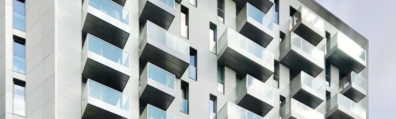 Windows and balconies on top floors at No. 3 Canalside Walk designed by Horden Cherry Lee.