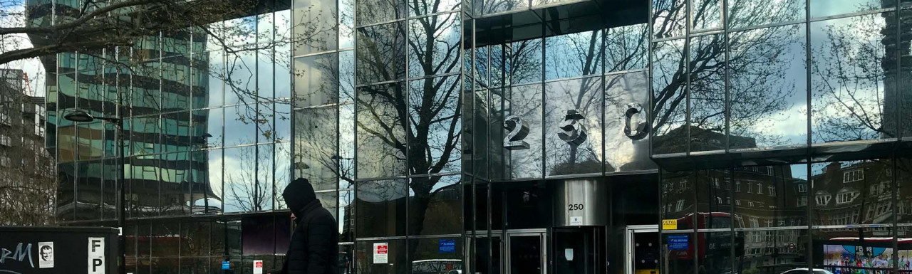 Entrance to 250 Euston Road on the corner of Euston Road and Hampstead Road in London NW1.