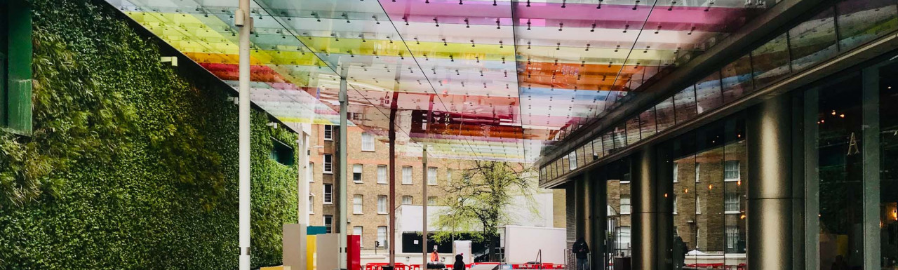 Colourful canopy designed by Pelli Clarke Pelli Architects at the new public space connects 62 Buckingham Gate to adjacent to Westminster City Hall.