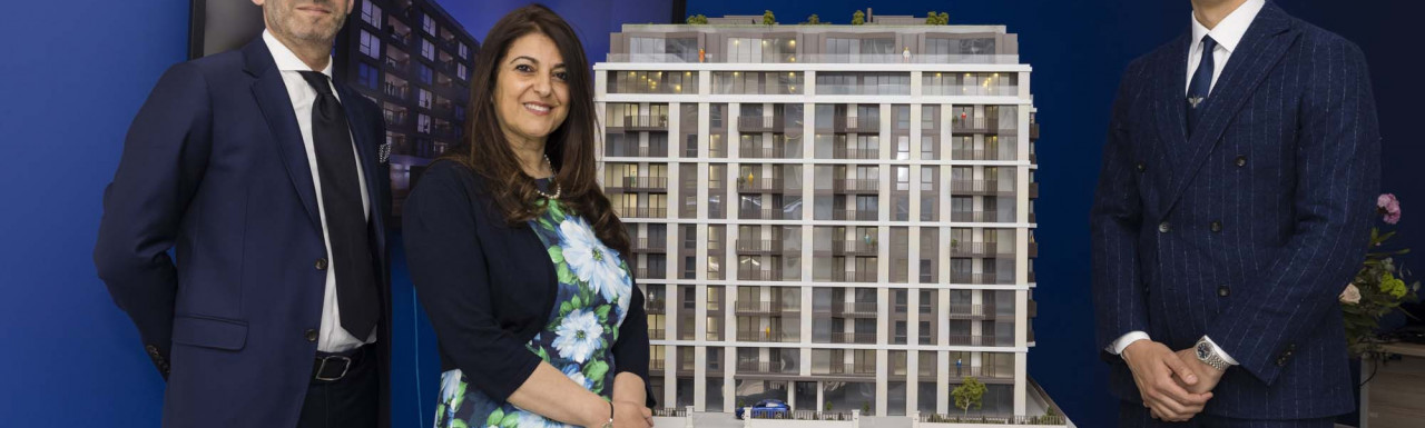 Rosy Khalastchy, Head of Office at Beauchamp Estates, and the model of One St John's Wood development.