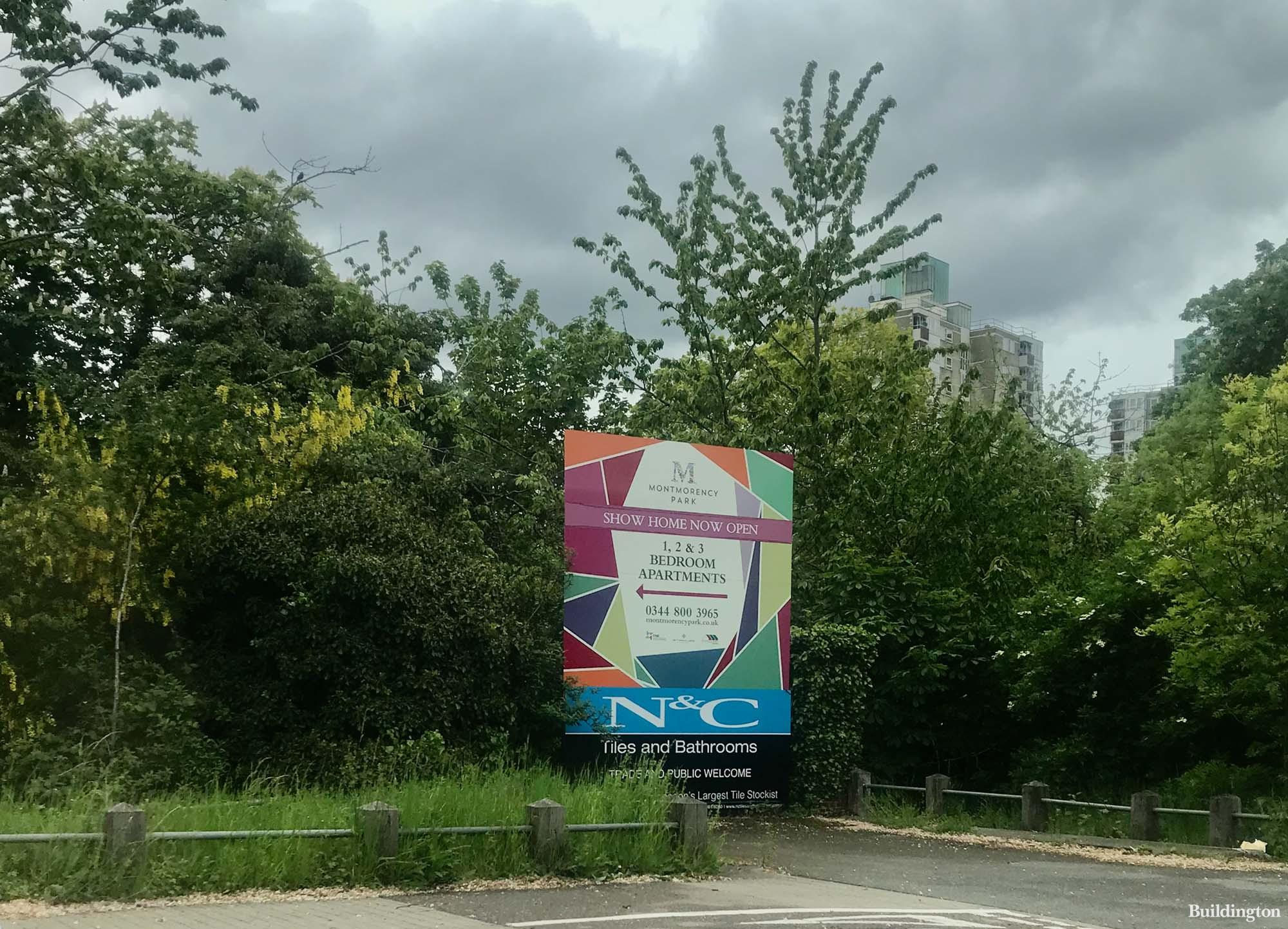 Montmorency Park development advertised beside M3 in London.