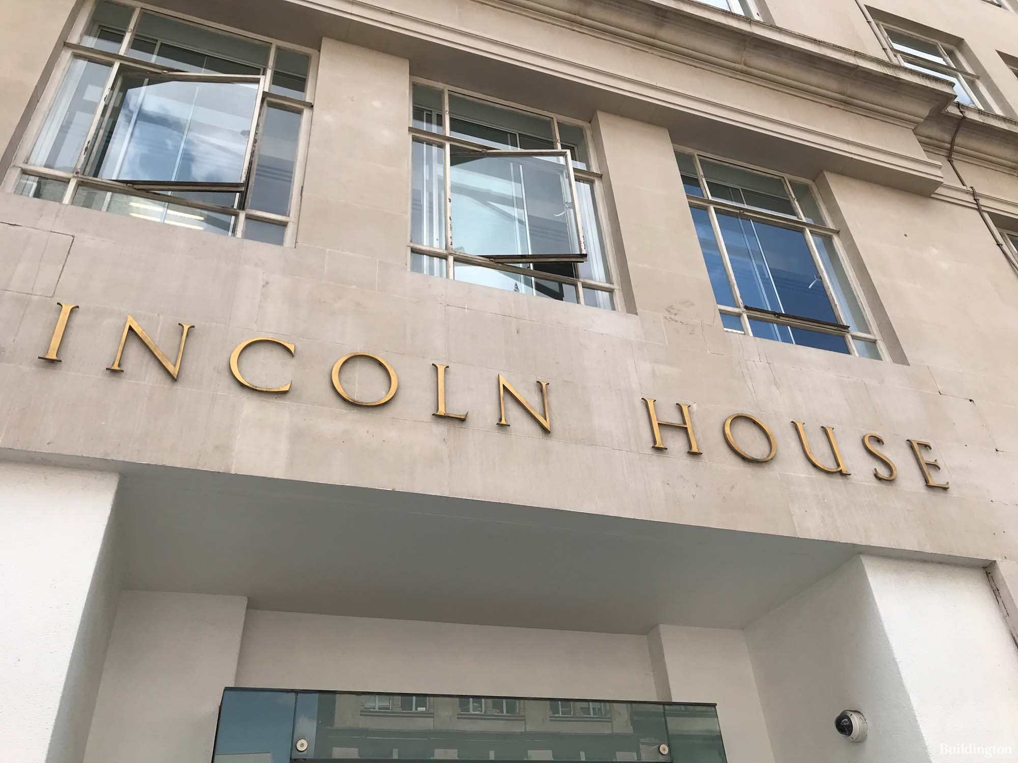 Lincoln House signage above the entrance on High Holborn, London WC1.