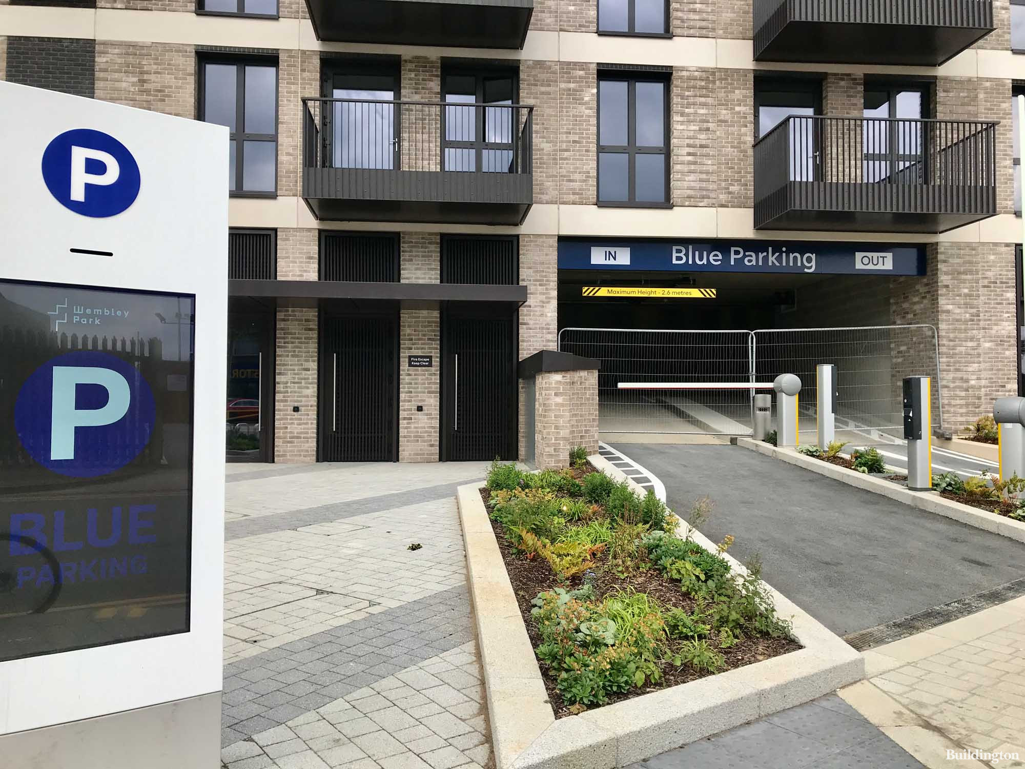 Blue Parking entrance at The Robinson South building on First Way in Wembley HA9. Residents parking has a separate entrance on the side of the building with an entrance on First Way.