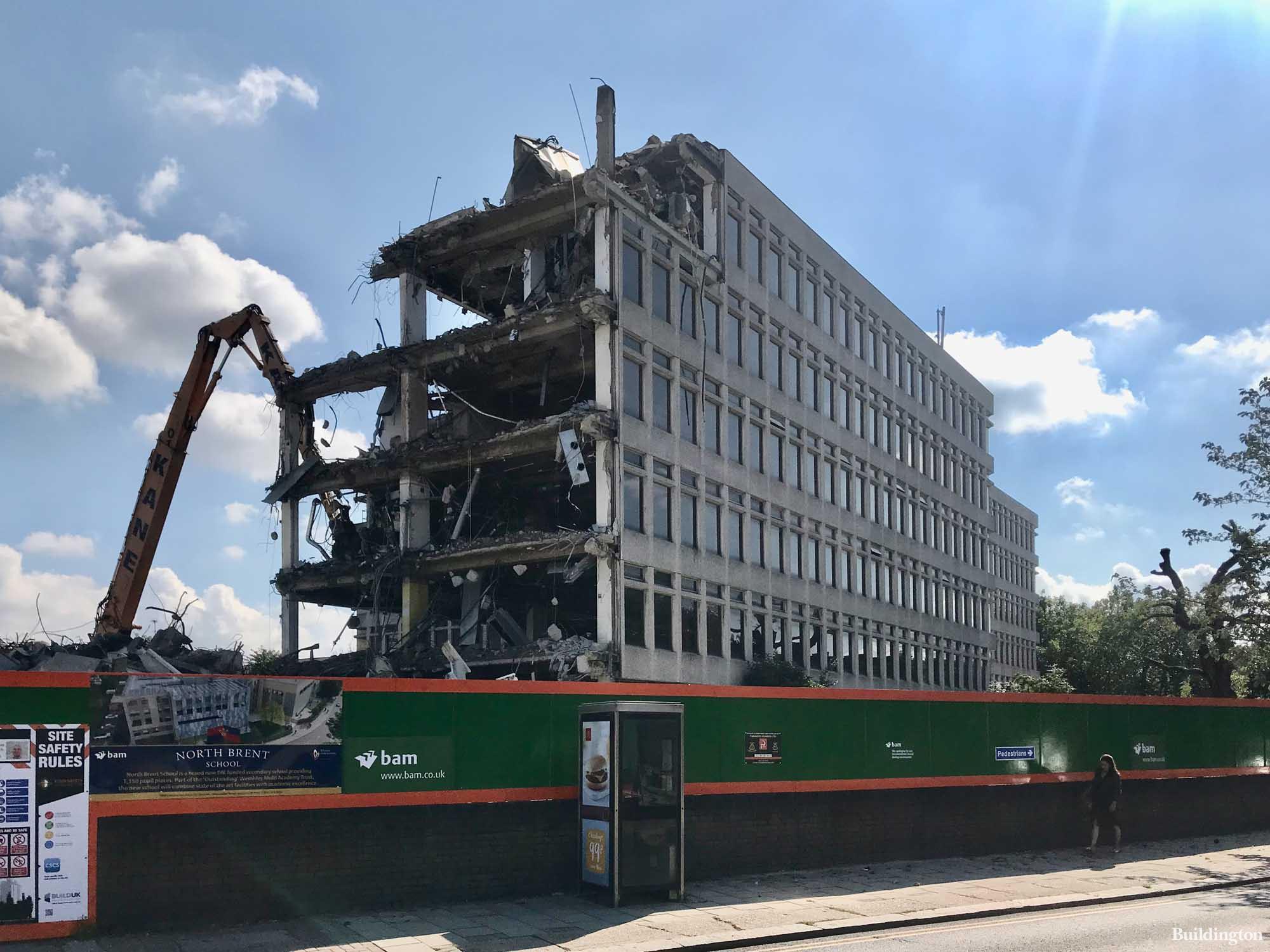 Chancel House office building demolition at Brent North School site on Neasden Lane.