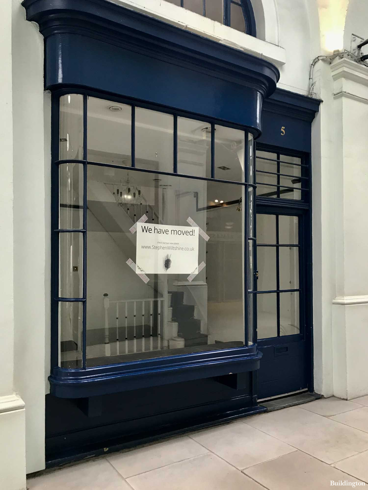 Royal Opera Arcade shop - we have moved sign on the window.