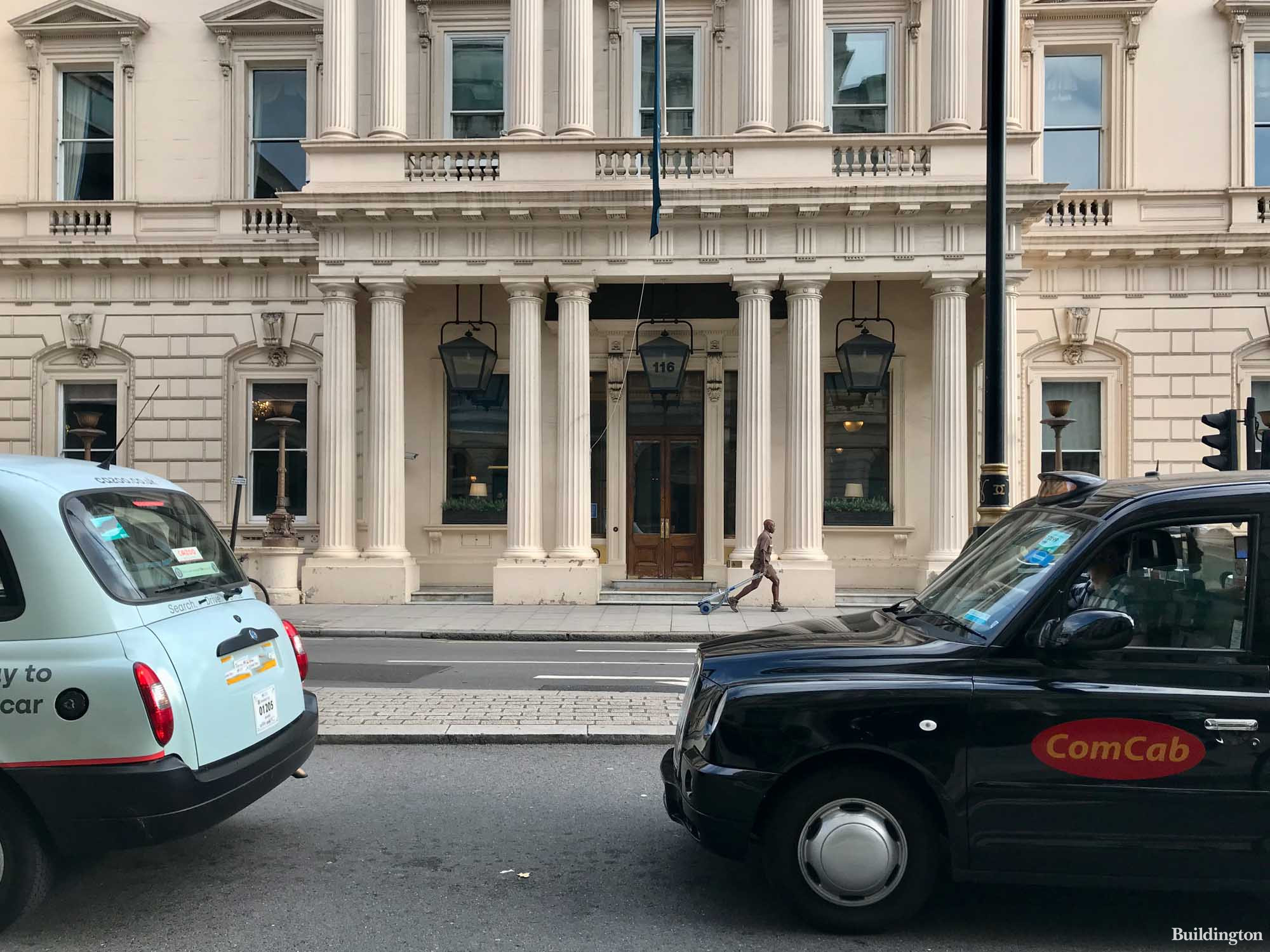In front of the Institute of Directors building on Pall Mall.