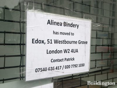 Sign at 46 Porchester Road shop window - Alinea Bindery has moved to Edox, 51 Westbourne Grove.