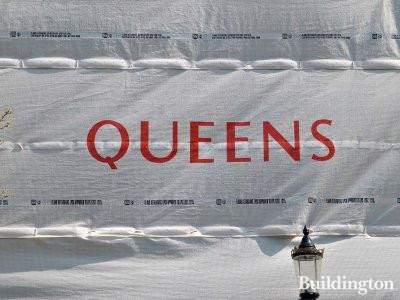 The development's name Queens on the side of the construction.