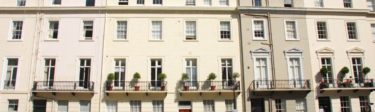 The ivory-colour house in the midddle.