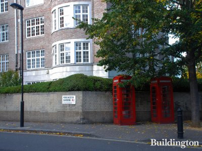 Two red phone booths and 2 Porchester Gardens in 2009.