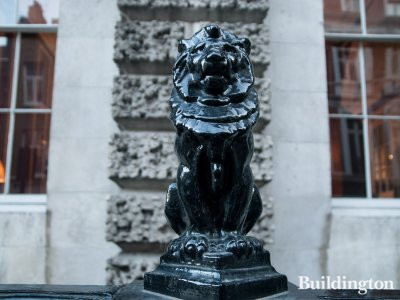 Lion on the railings in front of Ely House.