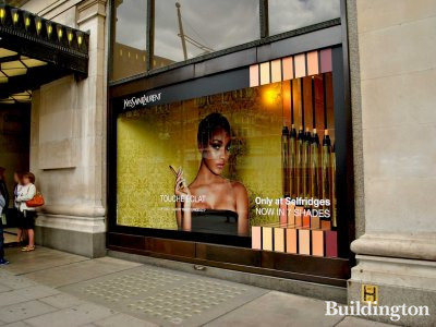 Selfridges window next to the main entrance.